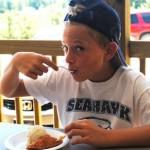 boy-eating-fried-apple-pie