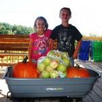 girl-boy-wagon-apples-pumpkins